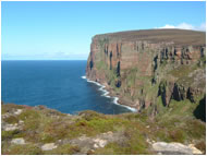 Pillars of flame - the stunning cliffs around St John's Head and the Old Man of Hoy